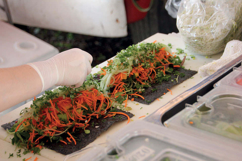 fresh hand made nori sushi roll being made