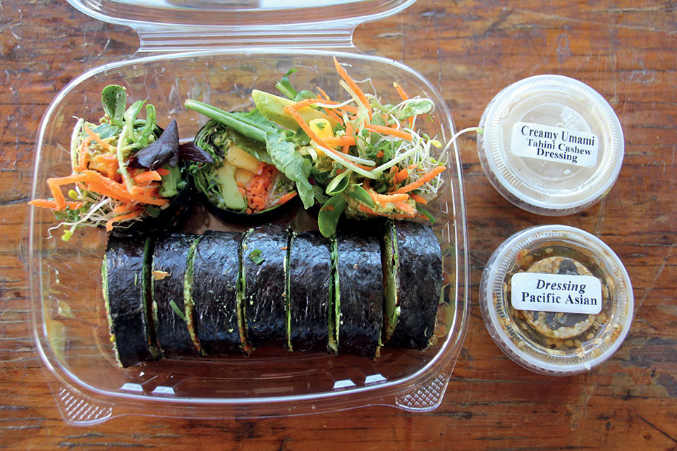 completed fresh hand made nori roll presented